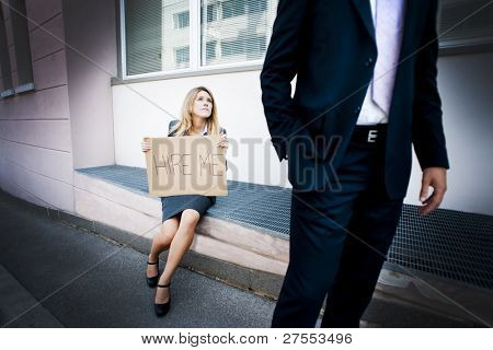 Young woman asking for a job, man looking indifferent
