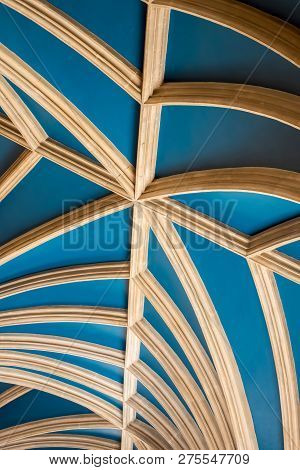 Vaulted Ceiling Curved Beam Abstract Architectural Detail Image. Blue Painted Ceiling With Curved Ti