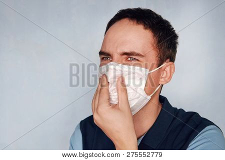 Man Closes His Mouth And Nose From Bad Smell Or Stinky Gas Bad Ecology. The Concept Of Gas Contamina