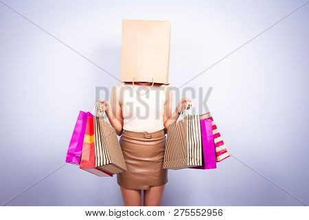 Portrait Of Women Blinded With The Shopping.  Conceptual Of Crazy Shopping Women.