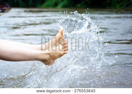 Girl Enjoying With Splashing Water Beside The River Close Up.