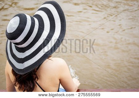 Women Who Wearing A Vintage Hat Sitting Near The River Close Up.