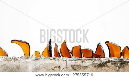 Pieces Of Broken Bottle Use For Anti Thief On Wall.