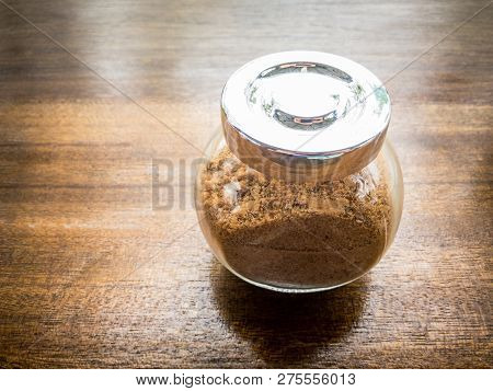 Brown Sugar In Glass Bottle Close Up.