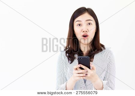 Asian Women In White Suit Looking At Her Smartphone Interestingly