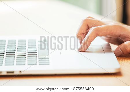 Women Using A Trackpad On The Modern Laptop To Access Into The Internet.  Concept Of Digital Life Wi