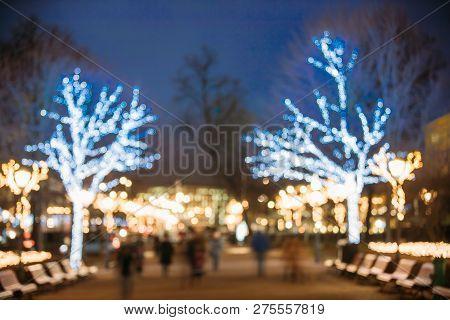 Helsinki, Finland. Defocused Blue Bokeh Background Of Esplanadi Park In Lighting At Evening Night Fe