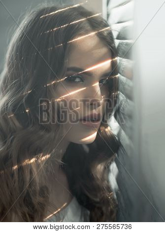 Elegant Girl With Fashionable Hair. Sensual Woman With Makeup At Window. Beauty And Fashion Look. Fa