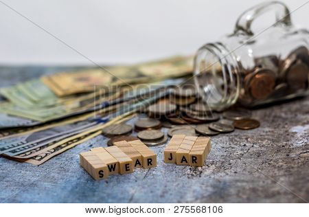 Swear Jar challenge concept with glass jar filled with coins, simple background poster