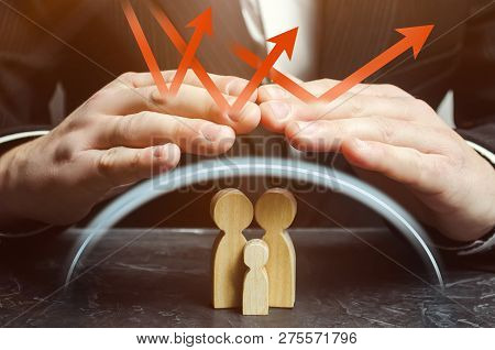 Insurance Agent Holds Hands Over Family. The Concept Of Insurance Of Family Life And Property. Healt