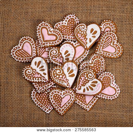 Decorated Heart Shape Gingerbread Cookies On Burlap Canvas Background