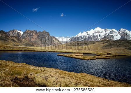 Panoramic View Of The Lake In Spectacular High Mountains, Cordillera, Andes, Peru, With Colorfull Da