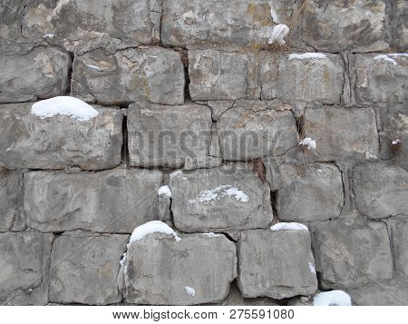 Broken Stone Wall In The Snow. Cement In The Winter In The Cold. Stock Photo Image