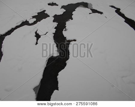 Cracks In The Ice In The Winter River In The Mountains. Stock Photo Image