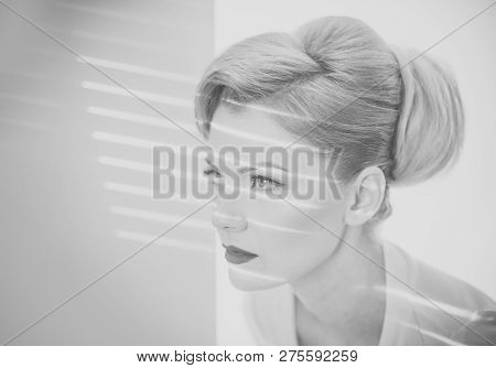 Woman Spy Concept. Girl With Strips Of Light And Shadows On Her Face. Lady With Blonde Hair And Eleg