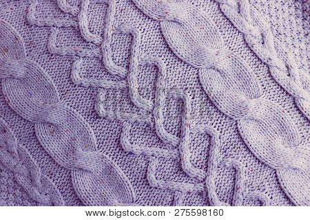 Beautiful Texture Of A Soft Warm Natural Sweater With A Knitted Pattern Of Threads. The Background.