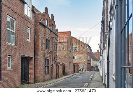 York, England - April 2018: Old Brick Buildings Along Ogleforth Street Towards Chapter House Street