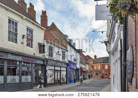 York, England - April 2018: Old Buildings Along Goodramgate Shopping Street In Historic District Of