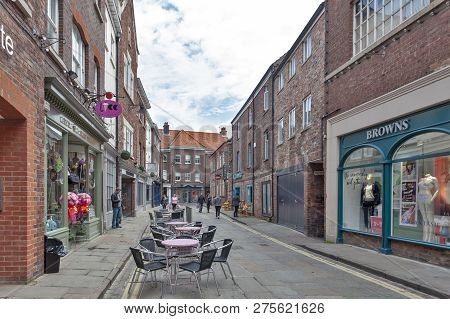 York, England - April 2018: Old Brick Buildings Housing Shops And Restaurants On Alley Of Back Swine