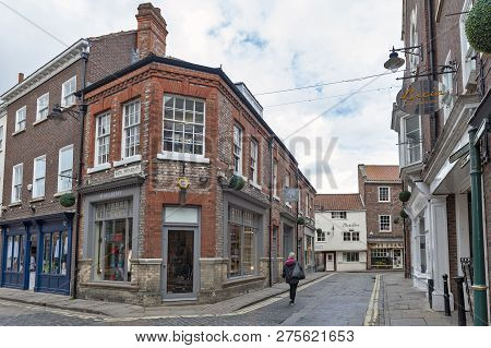 York, England - April 2018: Old Brick Building At Corner Of Swinegate Street In Historic District Of