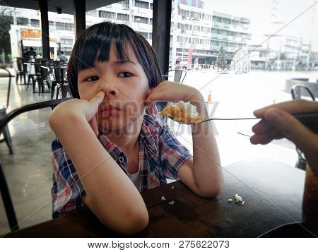 Bangkok, Thailand - December 25: Unidentified Seemingly Uncaring Boy Ignores His Mother As She Tries