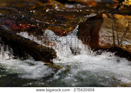 Spring Brook Flowing In Mountains Close-up. Water Concept