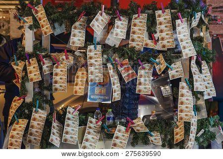 Thessaloniki, Greece - December 24 2018: Street Vendor Selling Greek Lottery Payslips. Evening Stree