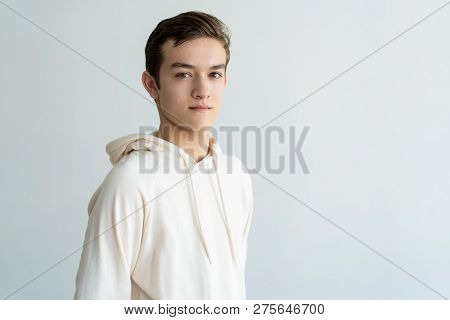Confident Handsome Teen Boy Looking At Camera. Young Man. Teen Boy Portrait Concept. Isolated View O
