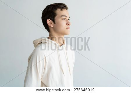 Dreamy Handsome Teen Boy Looking Away. Young Guy Dreaming. Teen Boy Portrait Concept. Isolated Side