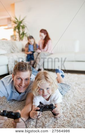 Father and son enjoying video games together in the living room