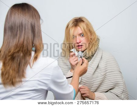 Treatment And When To Call Doctor. Doctor Woman Examine Sick Person. Recognize Symptoms Of Cold. Hom