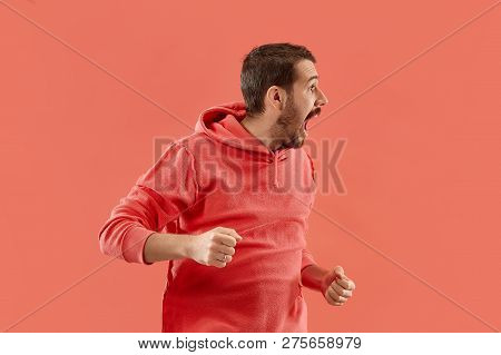 Screaming, Hate, Rage. Crying Emotional Angry Man Screaming On Coral Studio Background. Emotional, Y