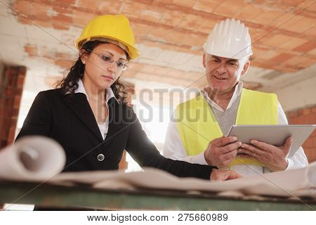 Female Architect And Foreman Meeting In Construction Site