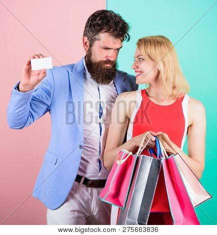 Ask Man To Purchase Lots Presents For Girlfriend. Paying While Dating. Couple With Luxury Bags In Sh