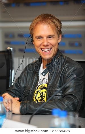 MOSCOW - MAY 6: Popular Dutch DJ Armin Van Buren smiles at a press conferences on May 6, 2011 in Moscow, Russia.