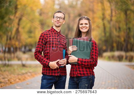 Economists Couple Decide Start Business Together. Friends Finally Graduated From University. Handsom