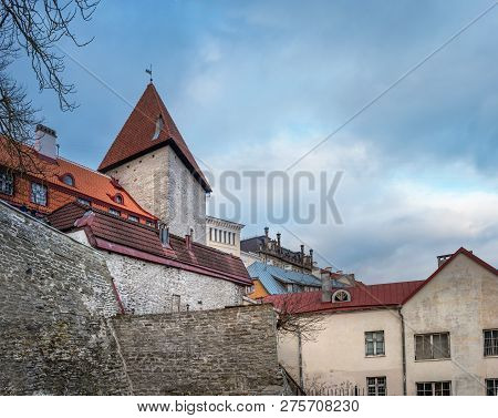 Fragment Of The Old Town. Old Town Is A Medieval District Of Tallinn, Estonia. Tiled Roofs And Stone