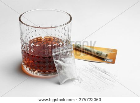 Composition With Cocaine And Glass Of Alcohol On White Background