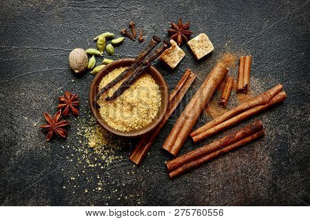 Assortment Of Winter Spices : Cinnamon, Anise, Cardamon, Nutmeg, Clove, Vanilla And Brown Sugar On A