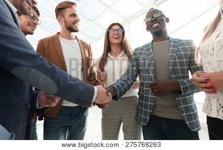 stylized image. handshake of international business partners