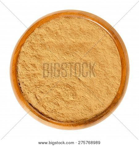 Cinnamon Powder In Wooden Bowl. Spice From Inner Bark Of The Ceylon Cinnamon Tree, Cinnamomum Verum.