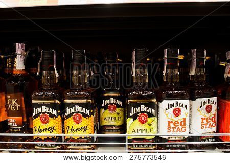 Kyiv, Ukraine - December 19, 2018: Bottles Of Jim Beam Honey, Apple And Red Stag On Shelves In A Sup