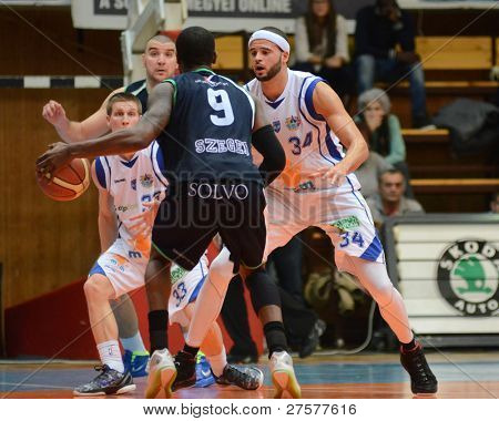 KAPOSVAR, HUNGARY - DECEMBER 10: Michael Fey (R) in action at a Hungarian Championship basketball game Kaposvar (white) vs. Szeged (blue) on December 10, 2011 in Kaposvar, Hungary.