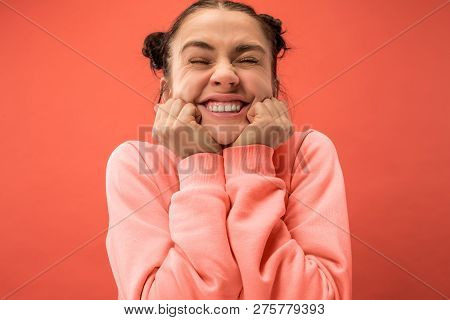 Happy Woman Standing And Smiling Isolated On Coral Studio Background. Beautiful Female Half-length P