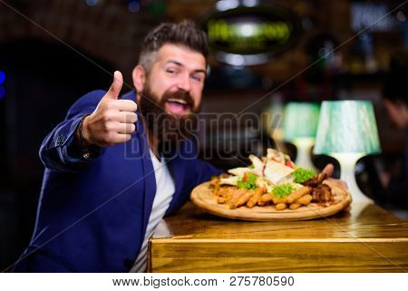 High Calorie Snack. Relax After Hard Day. Delicious Food. Businessman Formal Suit Sit At Restaurant.