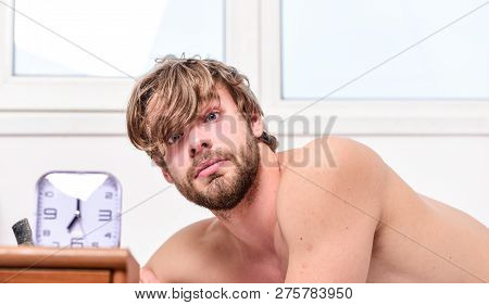 Man Unshaven Tousled Hair Wakeful Face Having Rest. Good Morning. Man Unshaven Lay Bed Near Alarm Cl
