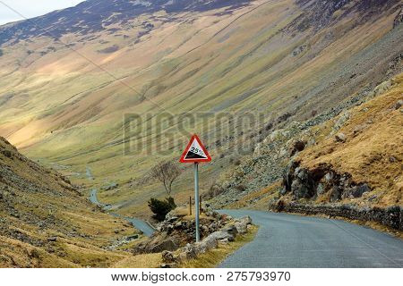Steep Hill Road Sign Long And Windy Road Going Downhill In The Lake District