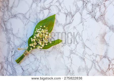 Bouquet Of Flowers Beautiful Smell Lily Of The Valley Or May-lily On Marble Background. Garden In Sp