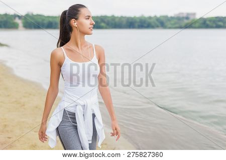Fitness Motivation. Athlete Female Fit Girl Runner Jogging And Running On Beach Lake In Park. Woman