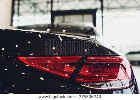 Back View Of New Black Car. Closeup Headlights Of Car. Black Premium City Crossover, Luxury Suv Rear